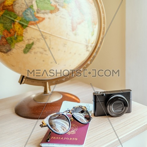 globe, digital camera,sun glasses,ticket airplane and passport on a wooden table. Idea, photo tourism, adventure, travel around the world