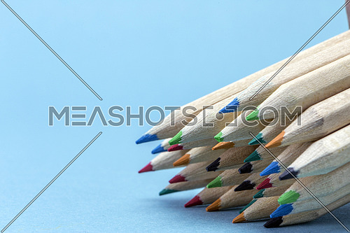 Texture of colored pencils isolated on blue background