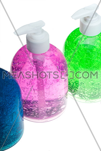 colorfull blue,pink and green hair gel bottles over white background