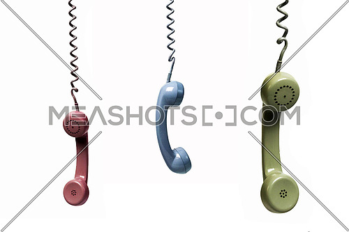 Three phones hanging from several colors isolated on a white background