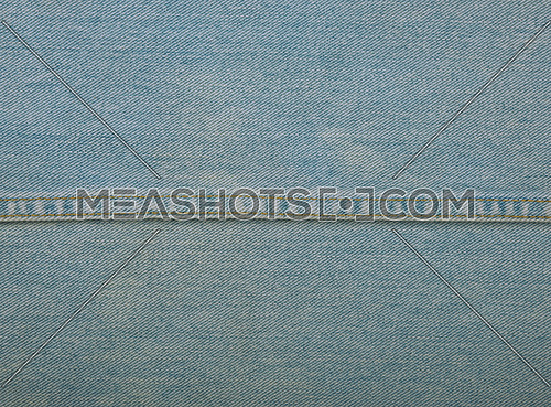 Light blue washed cotton jeans denim texture background with stitching seam edge line, close up