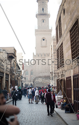 people and streets in the old town with traditional street stores in the Middle East