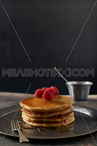 Pan cakes with red berries