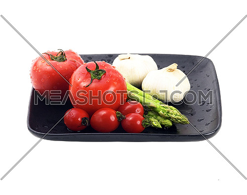 plate of fresh tomatoes ;cherry tomatoes asparagus and garlic ,typical mediterranean food