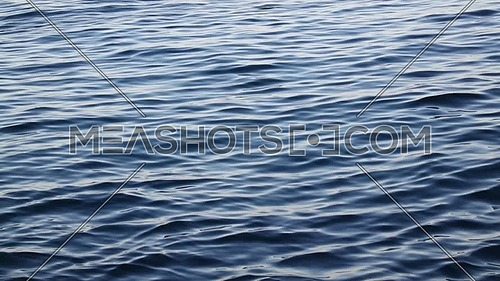 Background of blue sea waves with soft ripples running on water surface