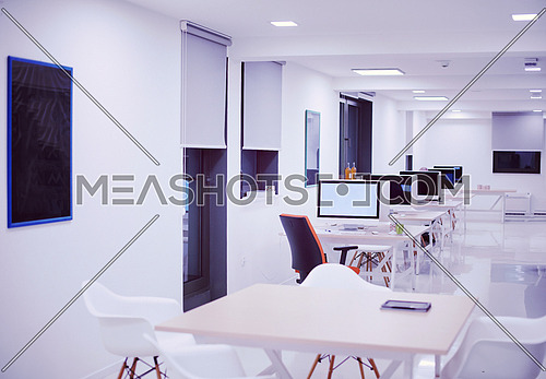 empty  startup office interior with modern computers and furniture