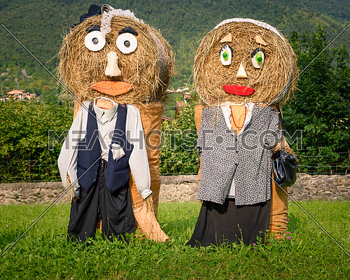 Farmers couple straw dolls outside italy