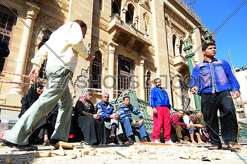 People standing in front of the islamic museum after A car bomb explosion at the police headquarters in Cairo on 24 January 2014