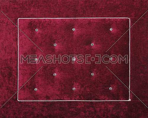 Close up background of purple burgundy color soft velvet bed headboard with rhinestone crystals, front view