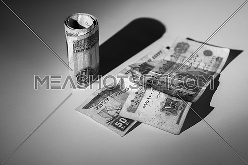 Egyptian Money on a grey table top black and white