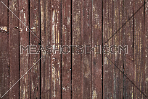 Close up background texture of red and brown weathered painted wooden planks, rustic style wall panel
