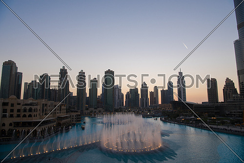 DUBAI UAE 31 JANUARY 2017 famous musical fountain in Dubai with skyscrapers in the background on a beautiful summer evening