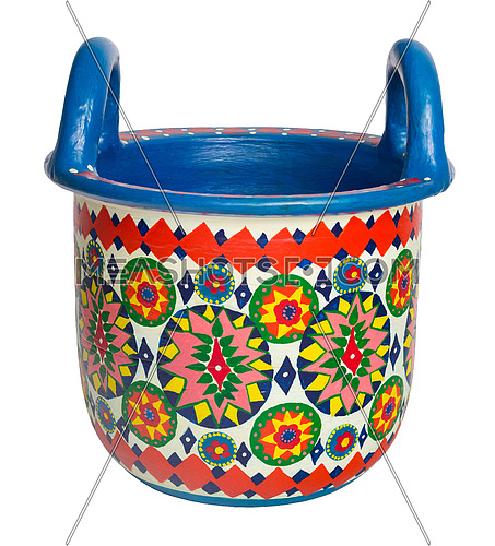 Handmade artistic pained colorful decorated pottery basket with two handles on white background with clipping path