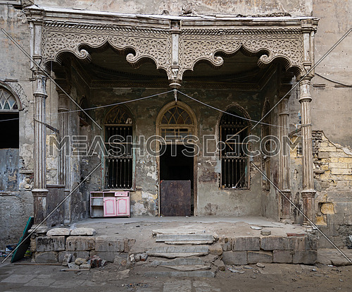Facade with Door and two window of an abandoned house, Cairo, Egypt