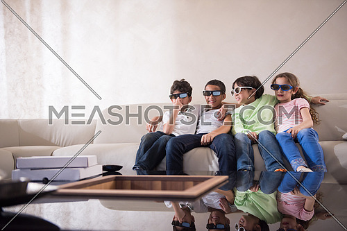 happy middle eastern children watch 3D movies and enjoy in cheerful moments on the sofa