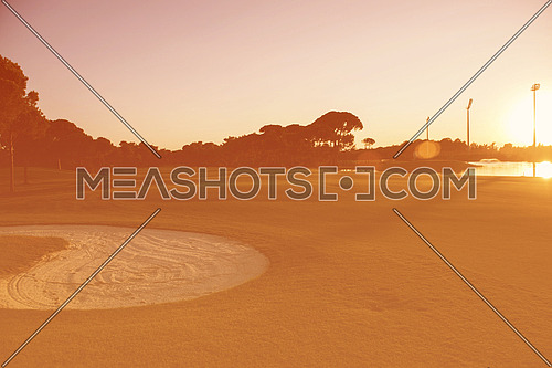 golf course landscape at beautiful sunset