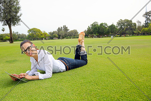 Beautiful young student  woman study with tablet in park