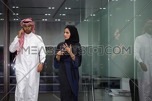Discussion after meeting, manager with his assistant