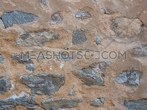 Grunge stone and clay wall. Natural stonewall texture for background