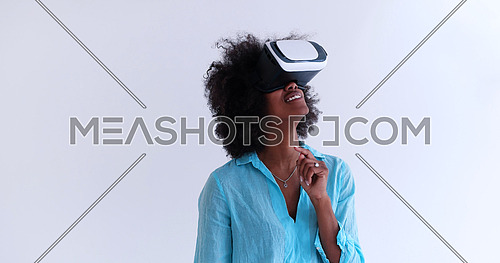Happy african american girl getting experience using VR headset glasses of virtual reality, isolated on white background