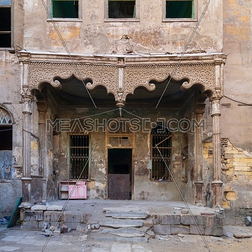 Facade of Bayt Madkour Pasha historic abandoned house located at Souq Al Selah Street, Darb Al Ahmar district, Old Cairo, Egypt