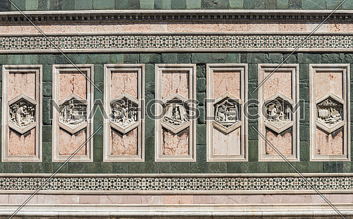 In the picture detail of the Basilica of Santa Maria del Fiore in Florence, a patterns of rectangular statues symmetrical.
