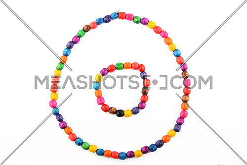 Colorful handmade wooden painted round beads necklace and bracelet isolated on white
