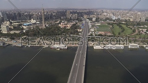 Aerial shot flying over Cairo Downtown empty streets showing 6th of October Bridge, The River Nile, and Cairo Tower during the corona pandemic lockdown by day 10 April 2020