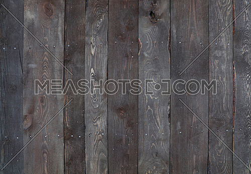 Old vintage aged grunge dark brown wooden floor planks texture background with stains and nails