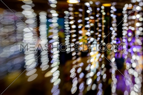 Abstract multicolored bokeh texture on black background