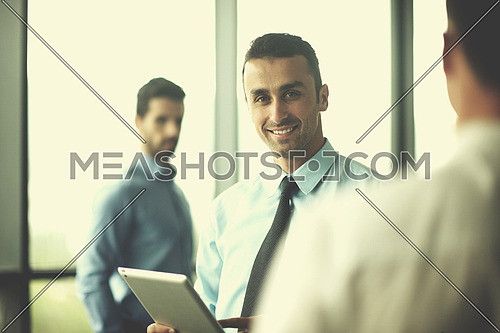 close-up of human hand  business man using tablet compuer at office