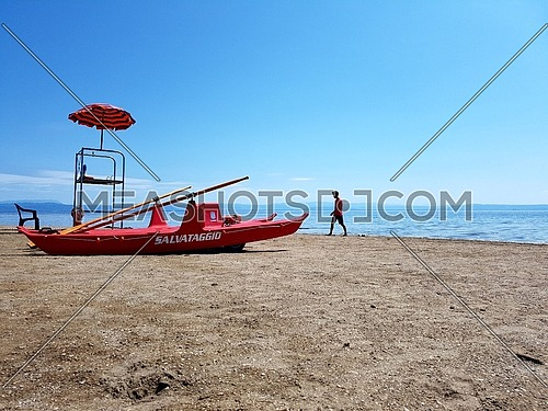 Mediterranean beach with lifeguard tower,umbrella and reascue boat moscone