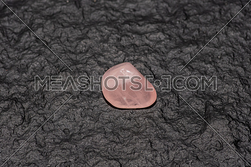 Raw rose quartz - semiprecious gem used for jewels and alternative medicine
