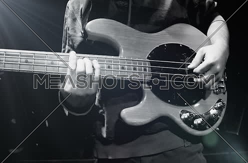 left handed Guitar Player Performing On Stage