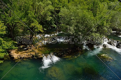 waterfall with clean and fresh water  nature with green forest in background