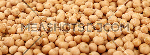 Dried chickpea beans at retail market display, close up pattern background, low angle view