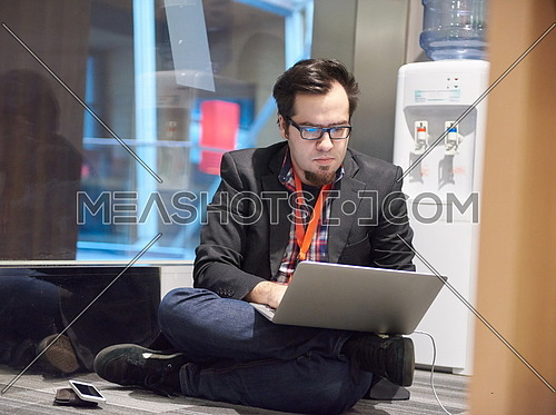 young business man in rush prepare conference presentation on laptop computer in startup company office interior