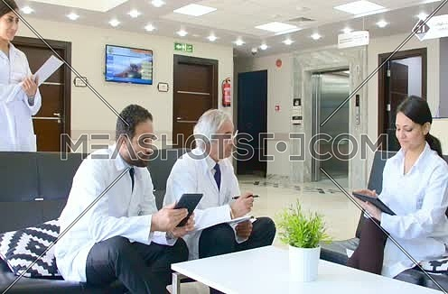 middle eastern doctors meeting and discussing with team