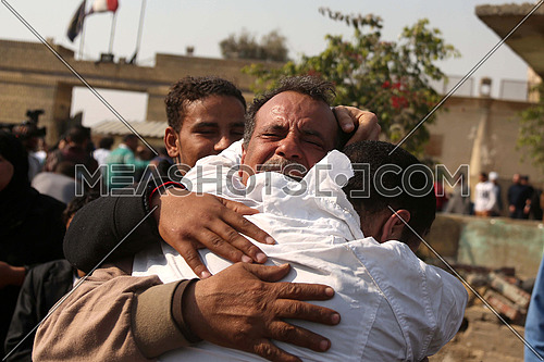 Father embraces his son after his release from the prison of Turah among the released by presidential pardon on 14 march 2017