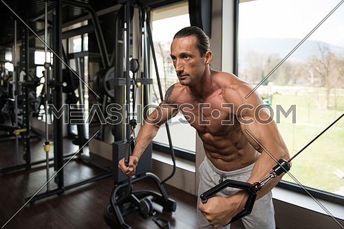 Muscular Mature Man Working Out Chest