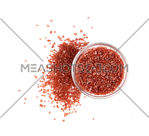 Close up one glass bowl saltcellar full of crystals red Hawaiian salt isolated on white background, elevated top view, directly above