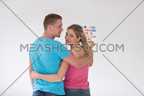repair, interior design, building, renovation and home concept smiling couple looking at color samples at home