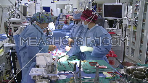 Tilt down for operation room during medical team is performing surgery