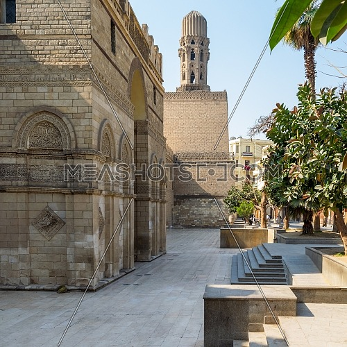 Cairo, Egypt- March 21 2015: Entrance of public historic Al Hakim Mosque known as The Enlightened Mosque with Minaret in the far end, located in Moez Street, Old Cairo