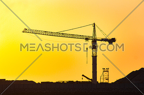 construction crane in sunset