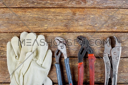 Industrial protective gloves, wrenches, steel on the table tools plumbing accessories