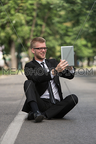 Happy Business Man Using Tablet Pc Outside To Take A Selfie