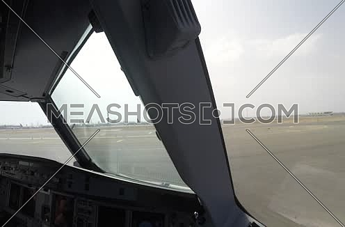 inside cockpit shot for plane moving on runway at Cairo Airport at day