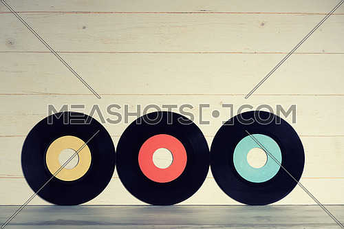 Vinyl records on wooden background,vintage style