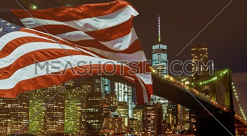 U.S. Flag flying of Brooklyn Bridge waterfront with Manhattan skyline in the background, with the World Trade Center
